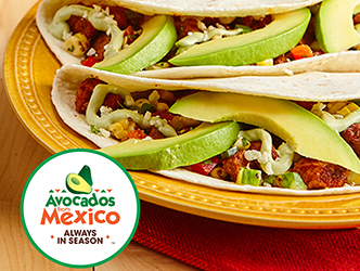 tacos with pork and avocados on a plate