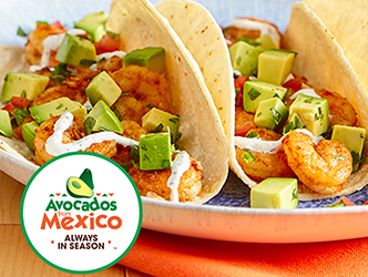 tacos with shrimp and avocado on a plate