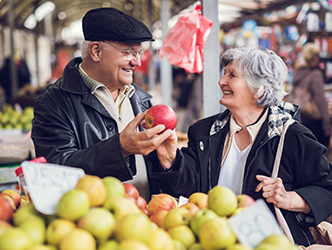 Older Couple shopping for produce