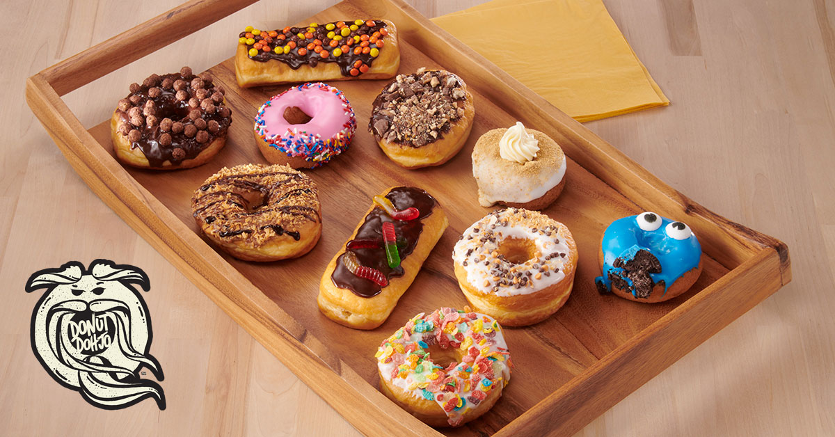 a selection of Donut Dohjo brand donuts on a wooden tray