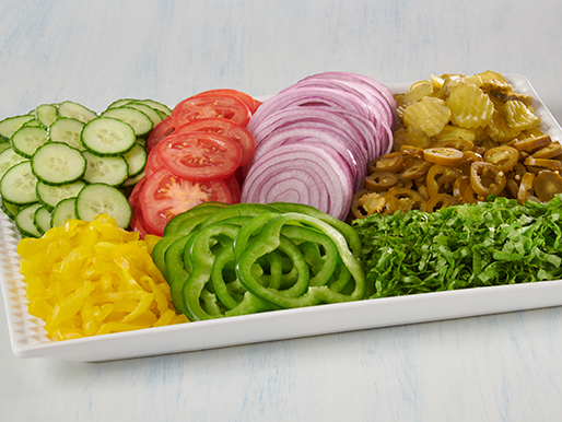 platter with fresh cut vegetables sandwich toppings