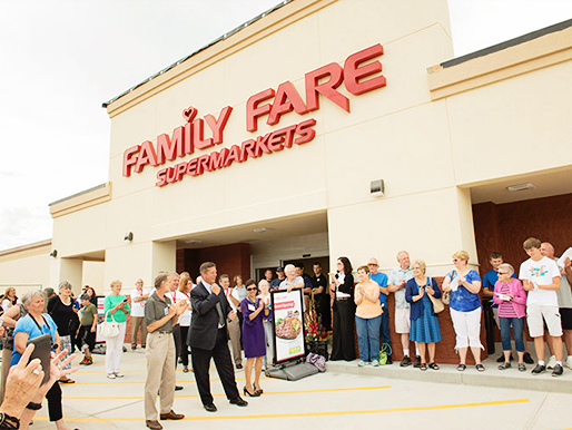 A large festive crowd applauds the grand opening of the Family Fare Store in Bellevue, Nebraska.