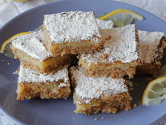 Lemon Squares with Cheerios stacked on a plate