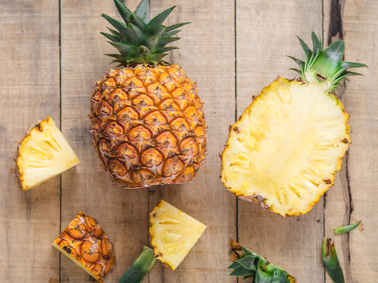 Whole and cut up pineapple