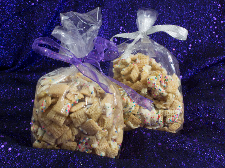 Gift giving with Sugar cookie chex mix in decorative bags with bows.jpg