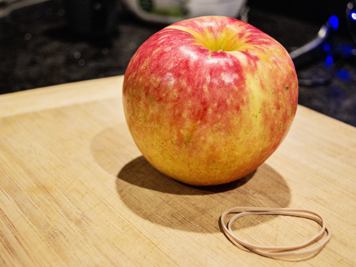 A whole apple before prepped for easy carrying.
