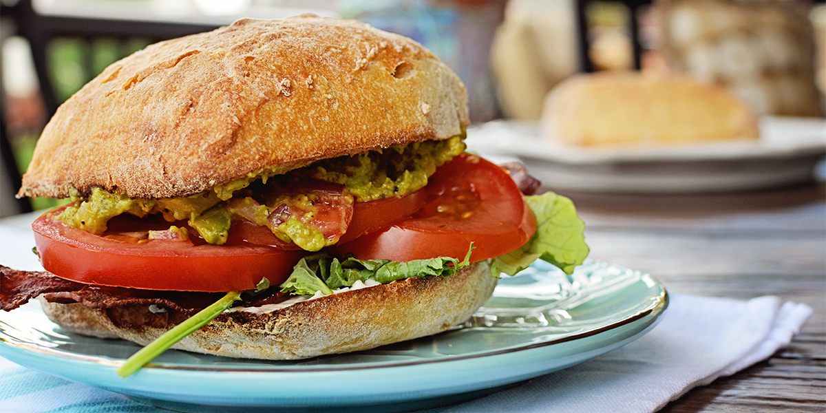 A BLT that goes beyond expectations sits on a plate after following Family Fare's Better BLT recipe.